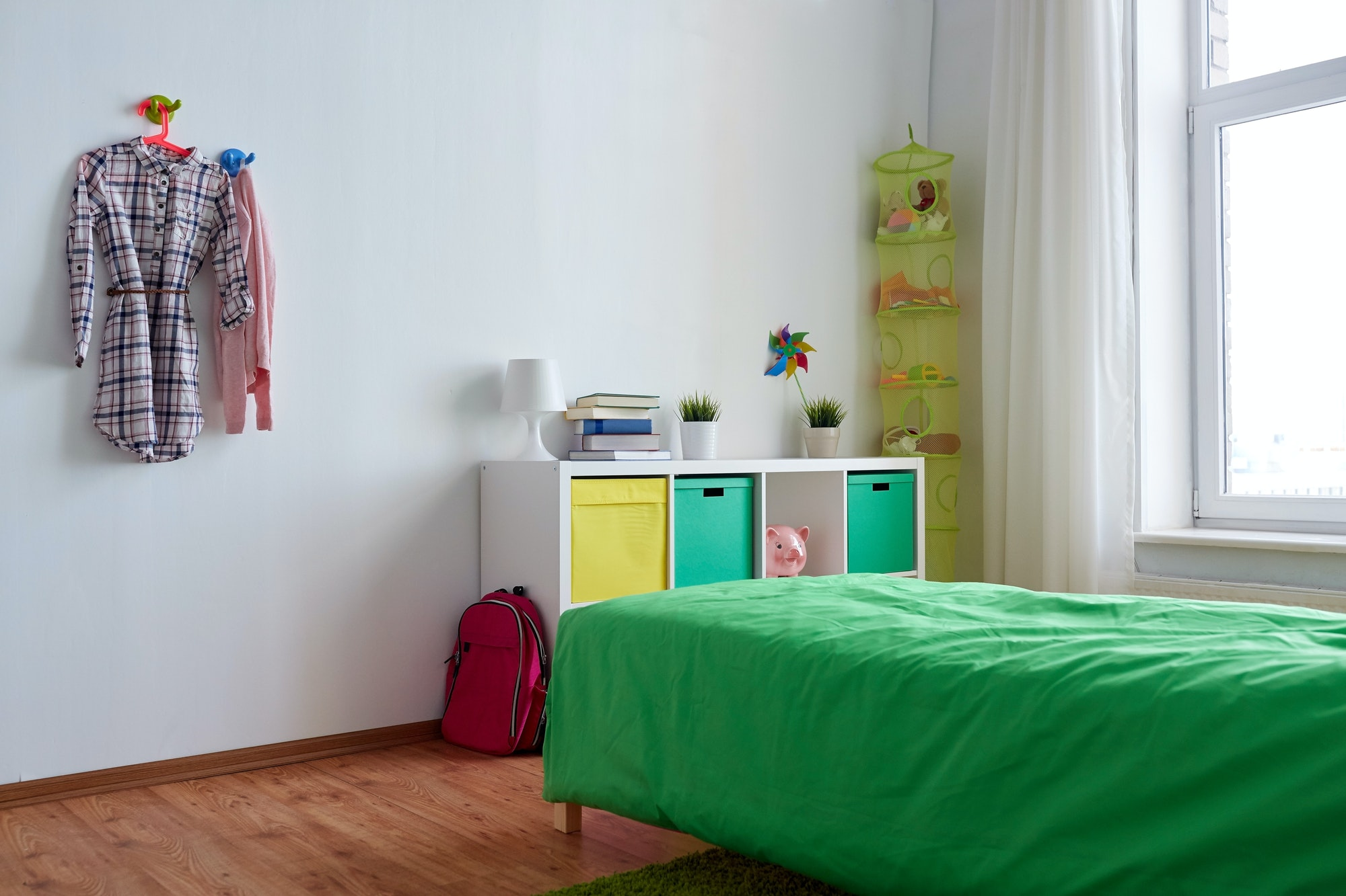 kids room interior with bed, rack and accessories